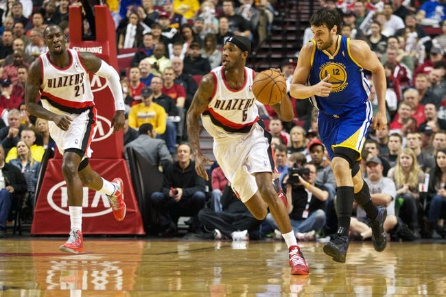 April 17, 2013; Portland, OR, USA; Portland Trail Blazers shooting guard Will Barton (5) heads up court past Golden State Warriors center Andrew Bogut (12) in the first half at the Rose Garden.  Mandatory Credit: Jaime Valdez-USA TODAY Sports