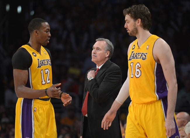 Apr 17, 2013; Los Angeles, CA, USA; Los Angeles Lakers coach Mike D'Antoni (center) talks with center Dwight Howard (12) and forward Pau Gasol (16) during the game against the Houston Rockets at the Staples Center. The Lakers defeated the Rockets 99-95 in overtime. Mandatory Credit: Kirby Lee-USA TODAY Sports