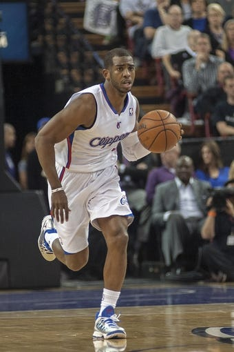 Apr 17, 2013; Sacramento, CA, USA; Los Angeles Clippers point guard Chris Paul (3) takes the ball up the court during the second quarter of the game against the Sacramento Kings at the Sleep Train Arena. The Los Angeles Clippers defeated the Sacramento Kings 112-108. Mandatory Credit: Ed Szczepanski-USA TODAY Sports