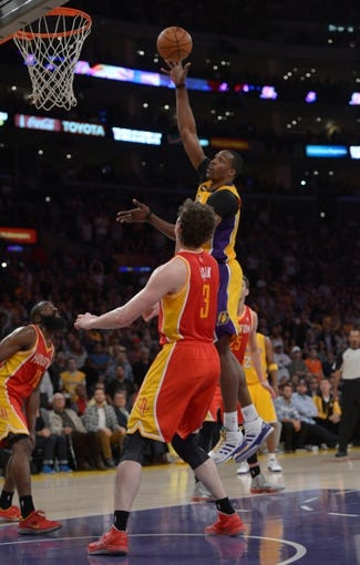 Apr 17, 2013; Los Angeles, CA, USA; Los Angeles Lakers center Dwight Howard (12) is defended by Houston Rockets guard James Harden (13) and center Omer Asik (3) at the Staples Center. The Lakers defeated the Rockets 99-95 in overtime. Mandatory Credit: Kirby Lee-USA TODAY Sports