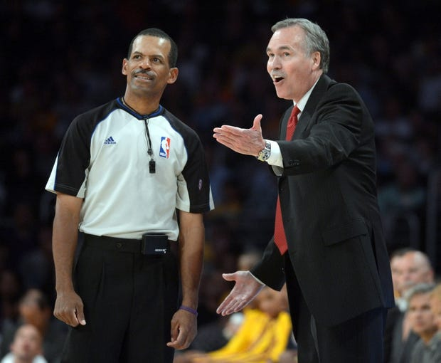 Apr 17, 2013; Los Angeles, CA, USA; Los Angeles Lakers coach Mike D'Antoni (right) argues with referee Eric Lewis (42) during the game against the Houston Rockets at the Staples Center. The Lakers defeated the Rockets 99-95 in overtime. Mandatory Credit: Kirby Lee-USA TODAY Sports