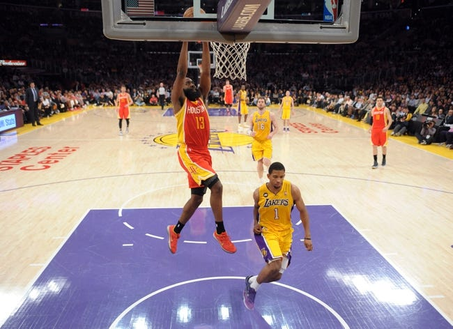 Apr 17, 2013; Los Angeles, CA, USA; Houston Rockets guard James Harden (13) dunks the ball as Los Angeles Lakers guard Darius Morris (1) defends at the Staples Center. The Lakers defeated the Rockets 99-95 in overtime. Mandatory Credit: Kirby Lee-USA TODAY Sports