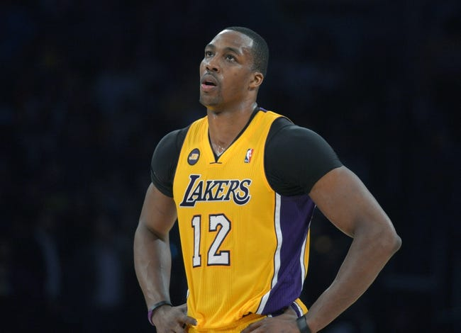 Apr 17, 2013; Los Angeles, CA, USA; Los Angeles Lakers center Dwight Howard (12) reacts during the game against the Houston Rockets at the Staples Center. The Lakers defeated the Rockets 99-95 in overtime. Mandatory Credit: Kirby Lee-USA TODAY Sports