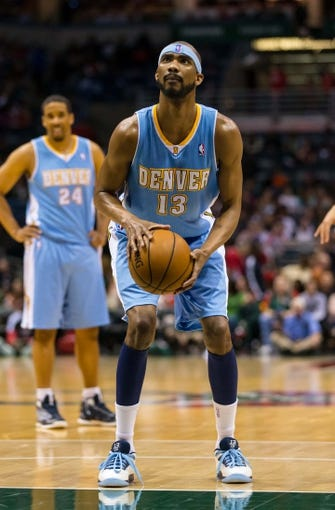 Apr 15, 2013; Milwaukee, WI, USA;  Denver Nuggets forward Corey Brewer (13) during the game against the Milwaukee Bucks at the BMO Harris Bradley Center.  Denver won 112-111.  Mandatory Credit: Jeff Hanisch-USA TODAY Sports