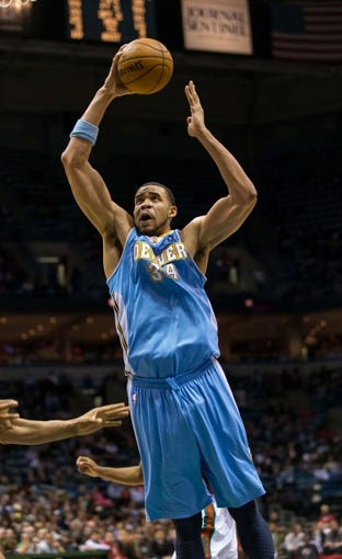 Apr 15, 2013; Milwaukee, WI, USA;  Denver Nuggets center JaVale McGee (34) during the game against the Milwaukee Bucks at the BMO Harris Bradley Center.  Denver won 112-111.  Mandatory Credit: Jeff Hanisch-USA TODAY Sports