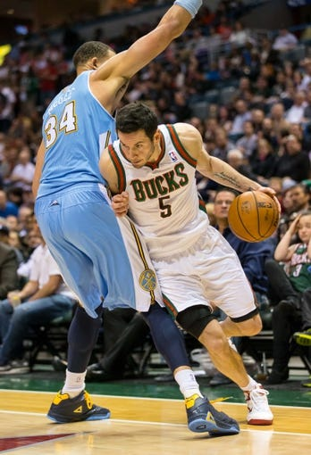 Apr 15, 2013; Milwaukee, WI, USA;  Milwaukee Bucks guard J.J. Redick (5) during the game against the Denver Nuggets at the BMO Harris Bradley Center.  Denver won 112-111.  Mandatory Credit: Jeff Hanisch-USA TODAY Sports