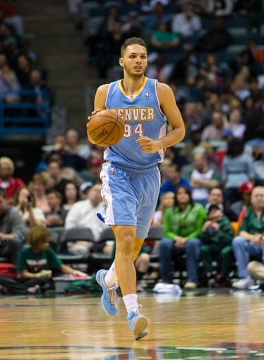 Apr 15, 2013; Milwaukee, WI, USA;  Denver Nuggets guard Evan Fournier (94) during the game against the Milwaukee Bucks at the BMO Harris Bradley Center.  Denver won 112-111.  Mandatory Credit: Jeff Hanisch-USA TODAY Sports
