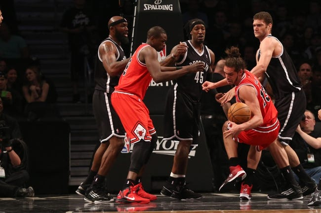 Apr 20, 2013; Brooklyn, NY, USA;  Chicago Bulls center Joakim Noah (13) is fouled during the third quarter against the Brooklyn Nets in game one of the first round of the 2013 NBA Playoffs at the Barclays Center. Brooklyn won106-89.  Mandatory Credit: Anthony Gruppuso-USA TODAY Sports