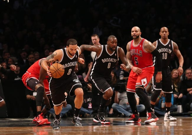 Apr 20, 2013; Brooklyn, NY, USA; Brooklyn Nets point guard Deron Williams (8) takes off with a rebound during the third quarter against the Chicago Bulls in game one of the first round of the 2013 NBA Playoffs at the Barclays Center. Brooklyn won106-89.  Mandatory Credit: Anthony Gruppuso-USA TODAY Sports