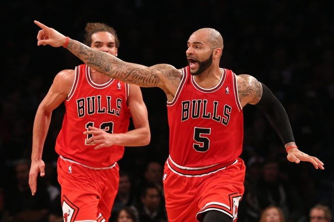 Apr 20, 2013; Brooklyn, NY, USA; Chicago Bulls power forward Carlos Boozer (5) gestures during the third quarter against the Brooklyn Nets in game one of the first round of the 2013 NBA Playoffs at the Barclays Center. Brooklyn won106-89.  Mandatory Credit: Anthony Gruppuso-USA TODAY Sports