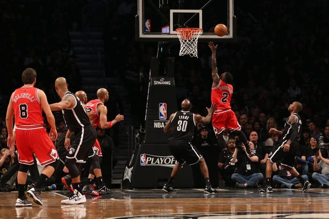 Apr 20, 2013; Brooklyn, NY, USA; Chicago Bulls point guard Nate Robinson (2) shoots over Brooklyn Nets power forward Reggie Evans (30) during the fourth quarter of game one of the first round of the 2013 NBA Playoffs at the Barclays Center. Brooklyn won106-89.  Mandatory Credit: Anthony Gruppuso-USA TODAY Sports