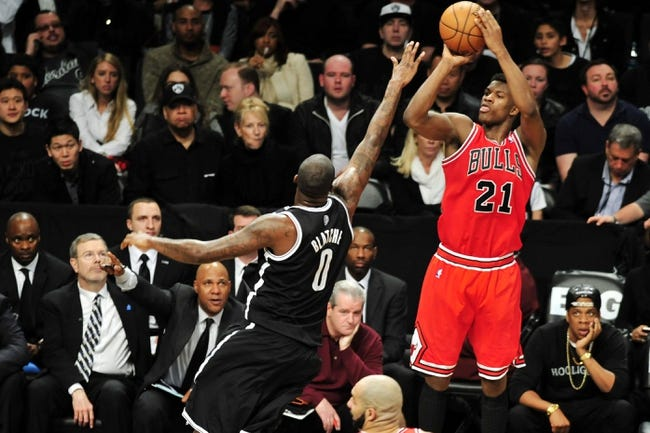 Apr 20, 2013; Brooklyn, NY, USA; Chicago Bulls small forward Jimmy Butler (21) takes a shot over Brooklyn Nets center Andray Blatche (0) during the second half of game one of the first round of the 2013 NBA Playoffs at the Barclays Center. The Nets won the game 106-89. Mandatory Credit: Joe Camporeale-USA TODAY Sports