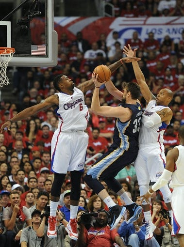 Apr 22, 2013; Los Angeles, CA, USA;  Los Angeles Clippers center DeAndre Jordan (6) and small forward Caron Butler (5) block a shot by Memphis Grizzlies center Marc Gasol (33) the second half of game one in the first round of the 2013 NBA playoffs at the Staples Center. Clippers won 93-91. Mandatory Credit: Jayne Kamin-Oncea-USA TODAY Sports