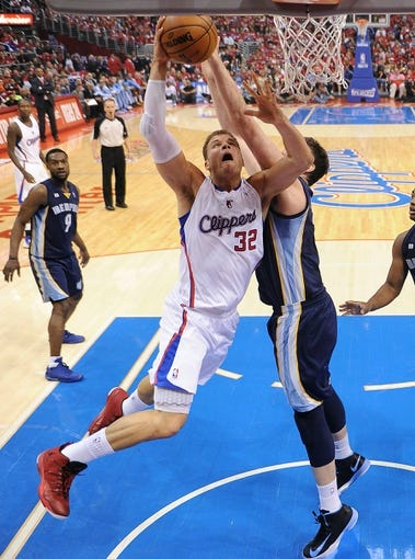 Apr 22, 2013; Los Angeles, CA, USA;  Memphis Grizzlies center Marc Gasol (33) defends Los Angeles Clippers power forward Blake Griffin (32) during game one in the first round of the 2013 NBA playoffs at the Staples Center. Clippers won 93-91. Mandatory Credit: Jayne Kamin-Oncea-USA TODAY Sports