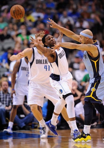 Apr 15, 2013; Dallas, TX, USA; Dallas Mavericks small forward Jae Crowder (9) defends against Memphis Grizzlies point guard Jerryd Bayless (7) at the American Airlines Center. Mandatory Credit: Jerome Miron-USA TODAY Sports