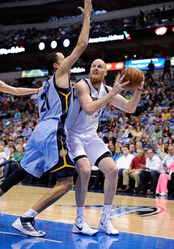 Apr 15, 2013; Dallas, TX, USA; Memphis Grizzlies small forward Tayshaun Prince (21) guards Dallas Mavericks center Chris Kaman (35) during the game at the American Airlines Center. Mandatory Credit: Jerome Miron-USA TODAY Sports