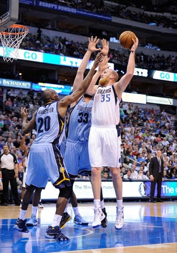 Apr 15, 2013; Dallas, TX, USA; Memphis Grizzlies small forward Quincy Pondexter (20) and power forward Zach Randolph (50) and center Marc Gasol (33) guard Dallas Mavericks center Chris Kaman (35) during the game at the American Airlines Center. Mandatory Credit: Jerome Miron-USA TODAY Sports