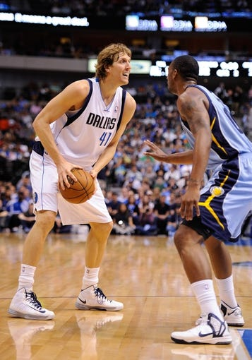 Apr 15, 2013; Dallas, TX, USA; Memphis Grizzlies power forward Darrell Arthur (00) guards Dallas Mavericks power forward Dirk Nowitzki (41) during the game at the American Airlines Center. Mandatory Credit: Jerome Miron-USA TODAY Sports