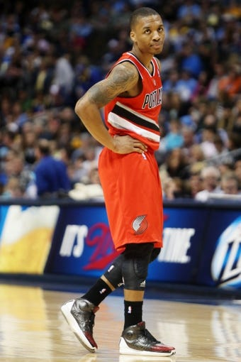 Apr 14, 2013; Denver, CO, USA; Portland Trailblazers guard Damian Lillard (0) during the second half against the Denver Nuggets at the Pepsi Center. Mandatory Credit: Chris Humphreys-USA TODAY Sports