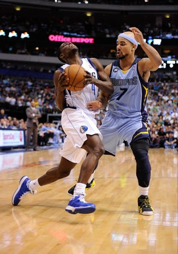 Apr 15, 2013; Dallas, TX, USA; Dallas Mavericks point guard Darren Collison (4) dribbles the ball past Memphis Grizzlies point guard Jerryd Bayless (7) during the game at the American Airlines Center. Mandatory Credit: Jerome Miron-USA TODAY Sports