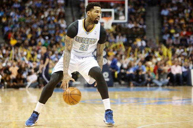 Apr 14, 2013; Denver, CO, USA; Denver Nuggets forward Wilson Chandler (21) drives to the basket during the second half against the Portland Trailblazers at the Pepsi Center. The Nuggets won 118-109.  Mandatory Credit: Chris Humphreys-USA TODAY Sports