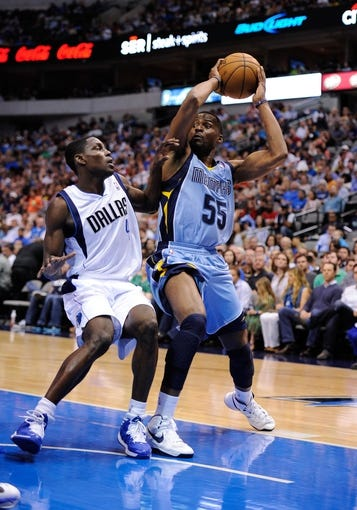 Apr 15, 2013; Dallas, TX, USA; Dallas Mavericks point guard Darren Collison (4) guards Memphis Grizzlies point guard Keyon Dooling (55) during the game at the American Airlines Center. Mandatory Credit: Jerome Miron-USA TODAY Sports
