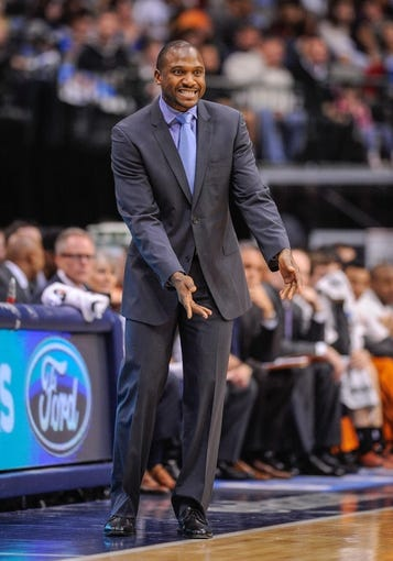 Apr 10, 2013; Dallas, TX, USA; Phoenix Suns head coach Lindsey Hunter motions to his team during the game between the Dallas Mavericks and the Suns at the American Airlines Center. The Suns defeated the Mavericks 102-91. Mandatory Credit: Jerome Miron-USA TODAY Sports
