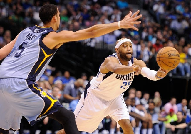 Apr 15, 2013; Dallas, TX, USA; Dallas Mavericks shooting guard Vince Carter (25) passes the ball by Memphis Grizzlies power forward Austin Daye (5) during the game at the American Airlines Center. Mandatory Credit: Jerome Miron-USA TODAY Sports
