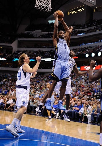 Apr 15, 2013; Dallas, TX, USA; Memphis Grizzlies shooting guard Tony Allen (9) grabs a rebound in front of Dallas Mavericks power forward Dirk Nowitzki (41) and point guard Mike James (13) during the game at the American Airlines Center. Mandatory Credit: Jerome Miron-USA TODAY Sports