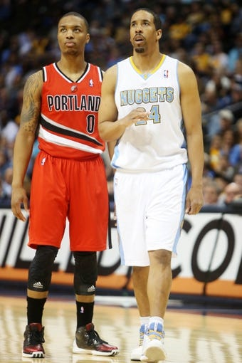 Apr 14, 2013; Denver, CO, USA; Portland Trailblazers guard Damian Lillard (0) and Denver Nuggets guard Andre Miller (24) during the first half at the Pepsi Center. Mandatory Credit: Chris Humphreys-USA TODAY Sports