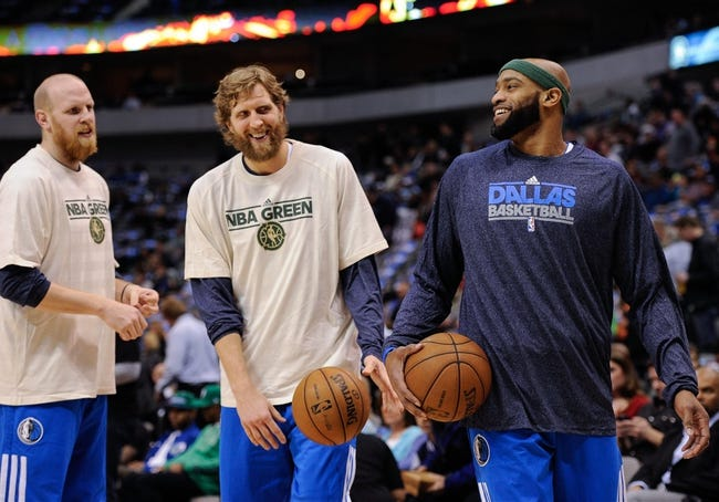Apr 10, 2013; Dallas, TX, USA; Dallas Mavericks center Chris Kaman (35) and power forward Dirk Nowitzki (41) and shooting guard Vince Carter (25) warm up before the game against the Phoenix Suns at the American Airlines Center. The Suns defeated the Mavericks 102-91. Mandatory Credit: Jerome Miron-USA TODAY Sports