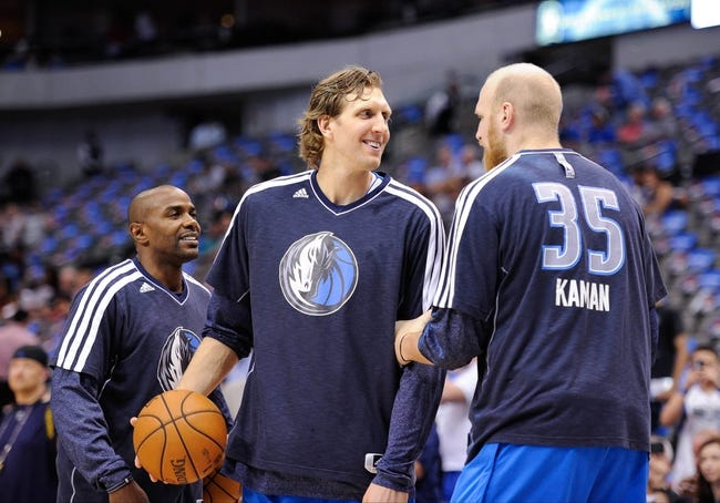 Apr 15, 2013; Dallas, TX, USA; Dallas Mavericks point guard Mike James (13) and power forward Dirk Nowitzki (41) and center Chris Kaman (35) warm up before the game against the Memphis Grizzlies at the American Airlines Center. Mandatory Credit: Jerome Miron-USA TODAY Sports
