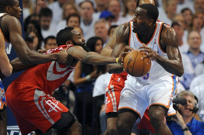 Apr 24, 2013; Oklahoma City, OK, USA; Houston Rockets guard James Harden (13) knocks the ball out of the hands of Oklahoma City Thunder center Kendrick Perkins (5)  in the first half during game two of the first round of the 2013 NBA Playoffs at Chesapeake Energy Arena. Mandatory Credit: Mark D. Smith-USA TODAY Sports