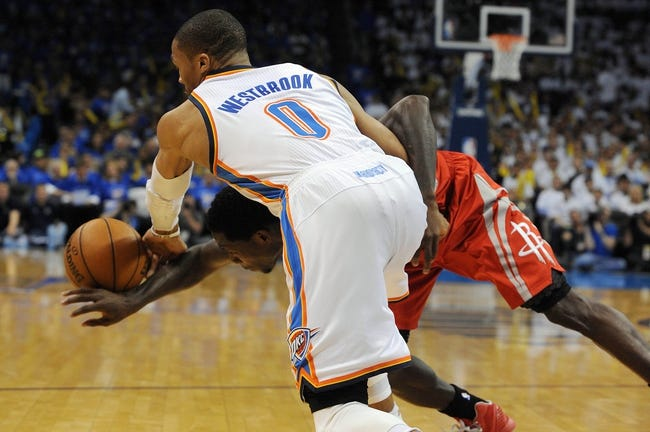 Apr 24, 2013; Oklahoma City, OK, USA; Oklahoma City Thunder guard Russell Westbrook (0) steals the ball from Houston Rockets guard Patrick Beverly (12) in the second half during game two of the first round of the 2013 NBA Playoffs at Chesapeake Energy Arena. Mandatory Credit: Mark D. Smith-USA TODAY Sports