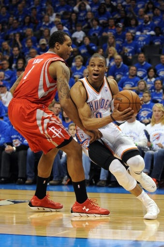 Apr 24, 2013; Oklahoma City, OK, USA; Oklahoma City Thunder guard Russell Westbrook (0) handles the ball against forward Greg Smith (4) in the second half during game two of the first round of the 2013 NBA Playoffs at Chesapeake Energy Arena. Mandatory Credit: Mark D. Smith-USA TODAY Sports