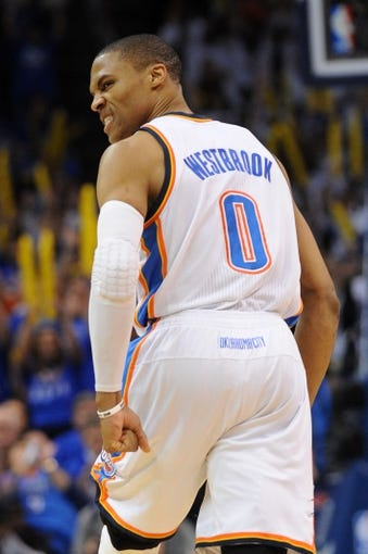 Apr 24, 2013; Oklahoma City, OK, USA; Oklahoma City Thunder guard Russell Westbrook (0) reacts to a play in action against the Houston Rockets in the second half during game two of the first round of the 2013 NBA Playoffs at Chesapeake Energy Arena. Mandatory Credit: Mark D. Smith-USA TODAY Sports