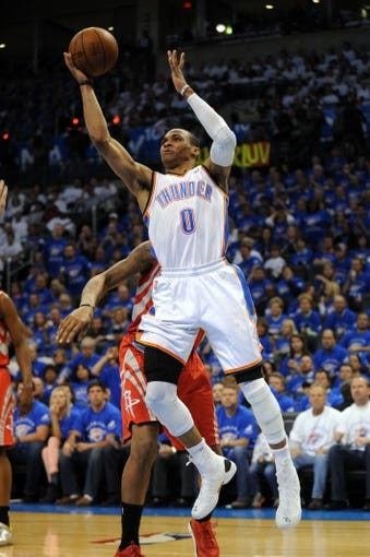 Apr 24, 2013; Oklahoma City, OK, USA; Oklahoma City Thunder guard Russell Westbrook (0) shoots the ball against forward Greg Smith (4) in the second half during game two of the first round of the 2013 NBA Playoffs at Chesapeake Energy Arena. Mandatory Credit: Mark D. Smith-USA TODAY Sports