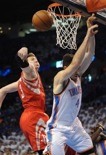 Apr 24, 2013; Oklahoma City, OK, USA; Oklahoma City Thunder forward Nick Collison (4) attempts a shot against Houston Rockets center Omer Asik (3) in the second half during game two of the first round of the 2013 NBA Playoffs at Chesapeake Energy Arena. Mandatory Credit: Mark D. Smith-USA TODAY Sports