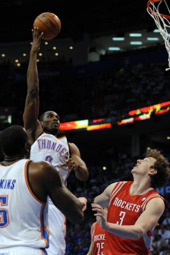 Apr 24, 2013; Oklahoma City, OK, USA; Oklahoma City Thunder forward Serge Ibaka (9) attempts a shot against Houston Rockets center Omer Asik (3) in the second half during game two of the first round of the 2013 NBA Playoffs at Chesapeake Energy Arena. Mandatory Credit: Mark D. Smith-USA TODAY Sports