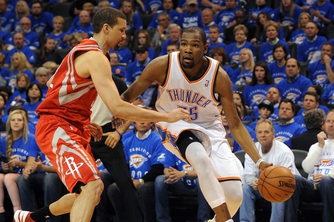 Apr 24, 2013; Oklahoma City, OK, USA; Oklahoma City Thunder forward Kevin Durant (35) handles the ball against Houston Rockets forward Greg Smith (4) in the second half during game two of the first round of the 2013 NBA Playoffs at Chesapeake Energy Arena. Mandatory Credit: Mark D. Smith-USA TODAY Sports