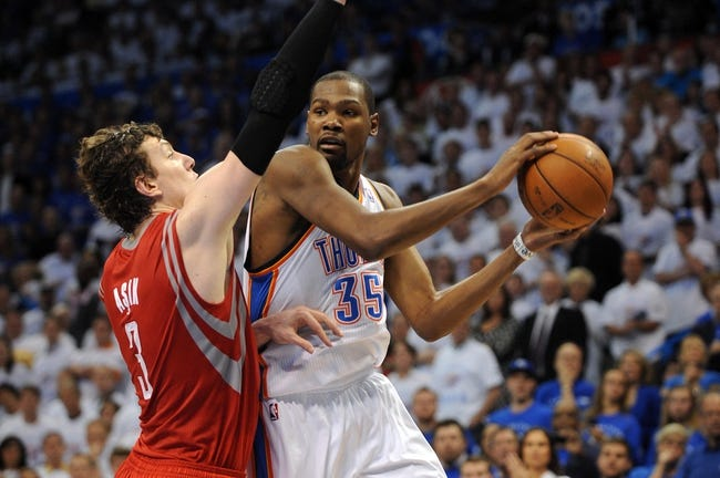 Apr 24, 2013; Oklahoma City, OK, USA; Oklahoma City Thunder forward Kevin Durant (35) attempts a shot against Houston Rockets cetner Omer Asik (3) in the second half during game two of the first round of the 2013 NBA Playoffs at Chesapeake Energy Arena. Mandatory Credit: Mark D. Smith-USA TODAY Sports