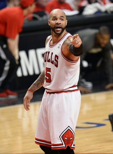 Apr 25, 2013; Chicago, IL, USA; Chicago Bulls power forward Carlos Boozer (5) reacts after a play against the Brooklyn Nets in the second half during game three of the first round of the 2013 NBA playoffs at the United Center. Chicago defeats Brooklyn 79-76. Mandatory Credit: Mike DiNovo-USA TODAY Sports