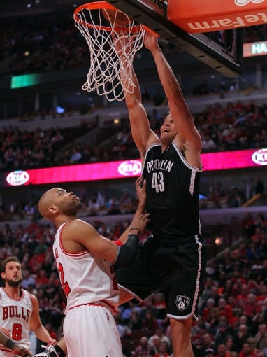 Apr 25, 2013; Chicago, IL, USA; Brooklyn Nets power forward Kris Humphries (43) dunks over Chicago Bulls power forward Taj Gibson (22) during the second half of game three of the first round of the 2013 NBA playoffs at the United Center. Chicago won 79-76. Mandatory Credit: Dennis Wierzbicki-USA TODAY Sports