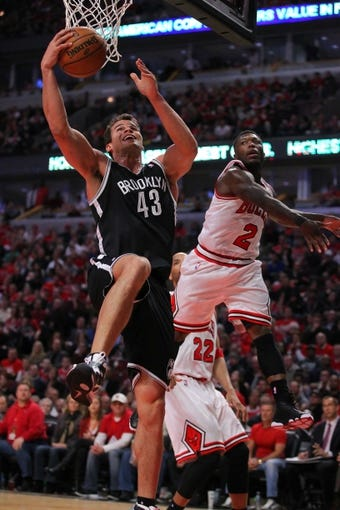 Apr 25, 2013; Chicago, IL, USA; Brooklyn Nets power forward Kris Humphries (43) drives past Chicago Bulls point guard Nate Robinson (2) during the second half of game three of the first round of the 2013 NBA playoffs at the United Center. Chicago won 79-76. Mandatory Credit: Dennis Wierzbicki-USA TODAY Sports