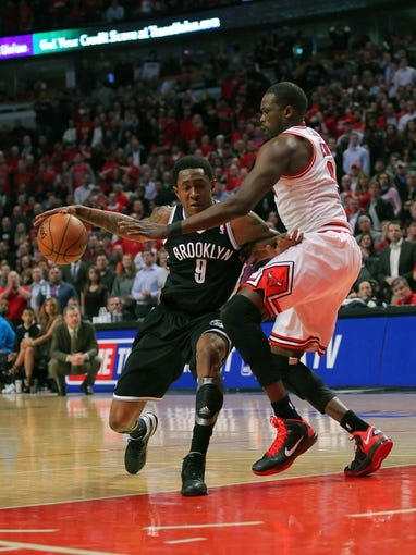 Apr 25, 2013; Chicago, IL, USA; Brooklyn Nets shooting guard MarShon Brooks (9) drives past Chicago Bulls small forward Luol Deng (9) during the second half of game three of the first round of the 2013 NBA playoffs at the United Center. Chicago won 79-76. Mandatory Credit: Dennis Wierzbicki-USA TODAY Sports