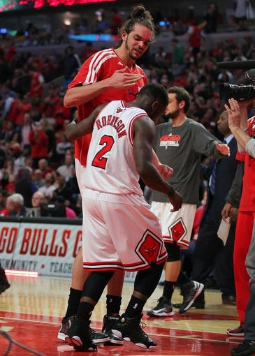 Apr 25, 2013; Chicago, IL, USA; Chicago Bulls point guard Nate Robinson (2) is congratulated by Chicago Bulls center Joakim Noah (13) during the second half of game three of the first round of the 2013 NBA playoffs against the Brooklyn Nets at the United Center. Chicago won 79-76. Mandatory Credit: Dennis Wierzbicki-USA TODAY Sports