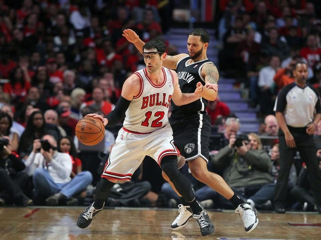 Apr 25, 2013; Chicago, IL, USA; Chicago Bulls shooting guard Kirk Hinrich (12) is defended by Brooklyn Nets point guard Deron Williams (8) during the second half of game three of the first round of the 2013 NBA playoffs at the United Center. Chicago won 79-76. Mandatory Credit: Dennis Wierzbicki-USA TODAY Sports