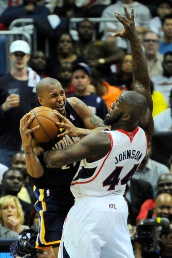 Apr 27, 2013; Atlanta, GA, USA; Indiana Pacers power forward David West (21) and Atlanta Hawks power forward Ivan Johnson (44) battle for the ball in the first half during game three in the first round of the 2013 NBA playoffs at Philips Arena. Mandatory Credit: Dale Zanine-USA TODAY Sports