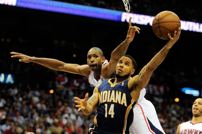 Apr 27, 2013; Atlanta, GA, USA; Atlanta Hawks center Al Horford (15) defends against Indiana Pacers point guard D.J. Augustin (14) during the second half during game three in the first round of the 2013 NBA playoffs at Philips Arena. The Hawks defeated the Pacers 90-69. Mandatory Credit: Dale Zanine-USA TODAY Sports