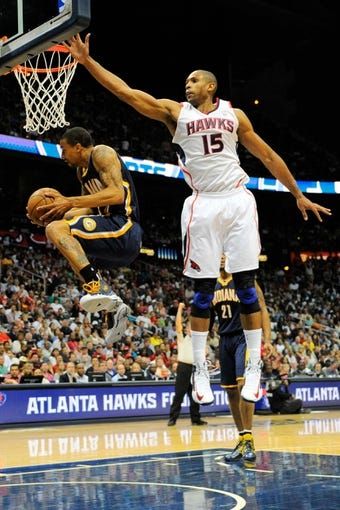 Apr 27, 2013; Atlanta, GA, USA; Indiana Pacers point guard George Hill (3) is defended by Atlanta Hawks center Al Horford (15) during the second half during game three in the first round of the 2013 NBA playoffs at Philips Arena. The Hawks defeated the Pacers 90-69. Mandatory Credit: Dale Zanine-USA TODAY Sports